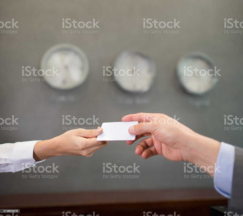 Successful people handling a business card stock photo