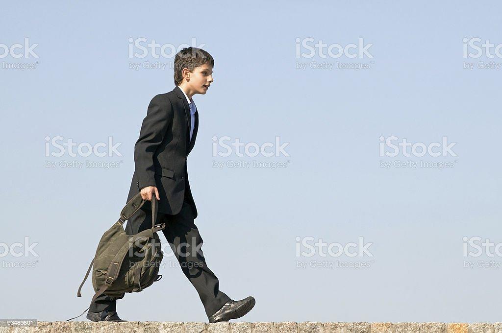 Successful school student walks home stock photo