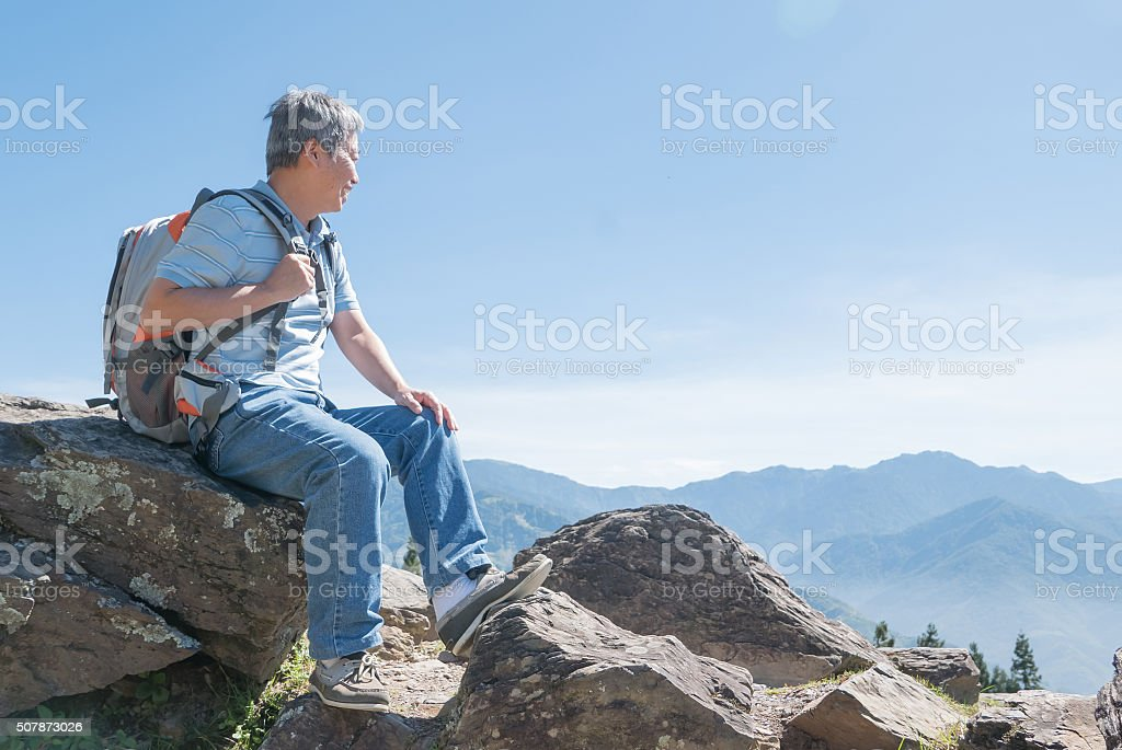 Successful senior man mountain hiker stock photo