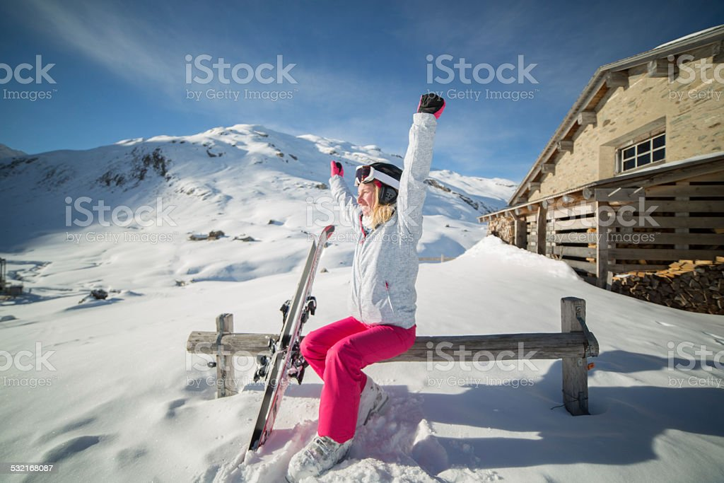 Successful skier on ski slopes near chalet-Winter stock photo