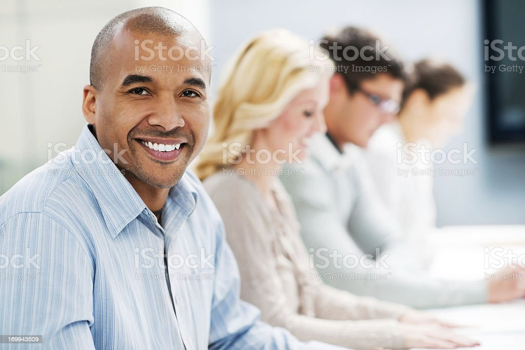 Successful smiling businessman on a meeting stock photo