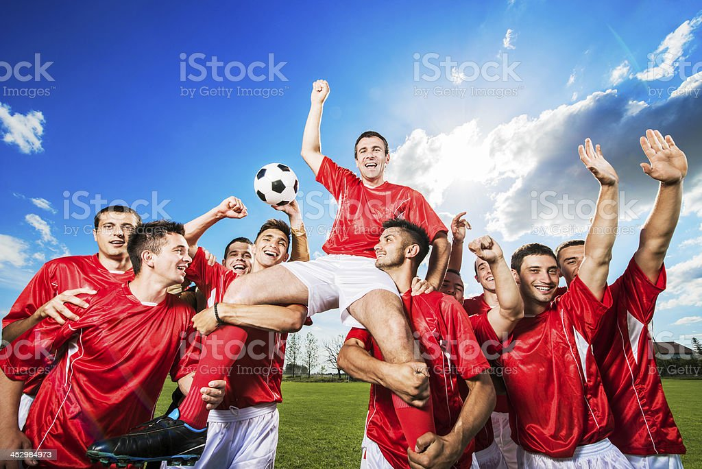 Successful soccer team against the sky. stock photo