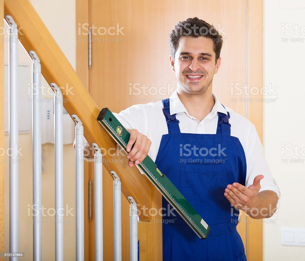 Successful specialist building stairway in new house stock photo