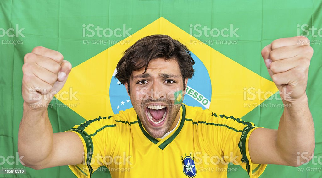 Successful Sportsman Shouting Against Brazilian Flag royalty-free stock photo