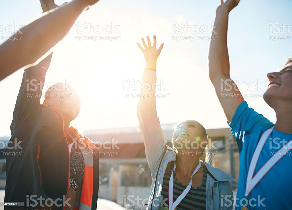 Successful team of athletes cheering victory stock photo