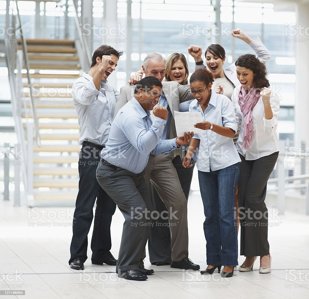 Successful team of business people excited about a new contract royalty-free stock photo
