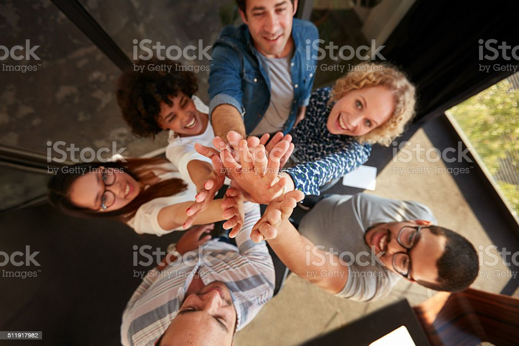 Successful team of professionals high fiving stock photo