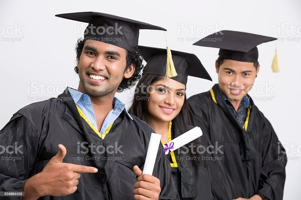 Successful three young college graduates stock photo