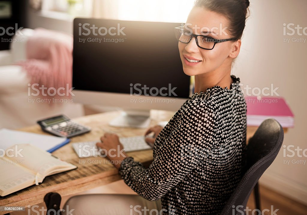 Successful woman at the home office stock photo