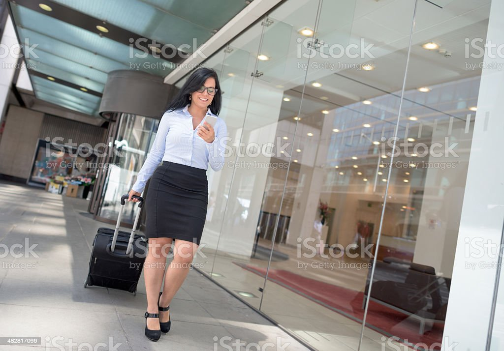 Successful woman going on a business trip stock photo