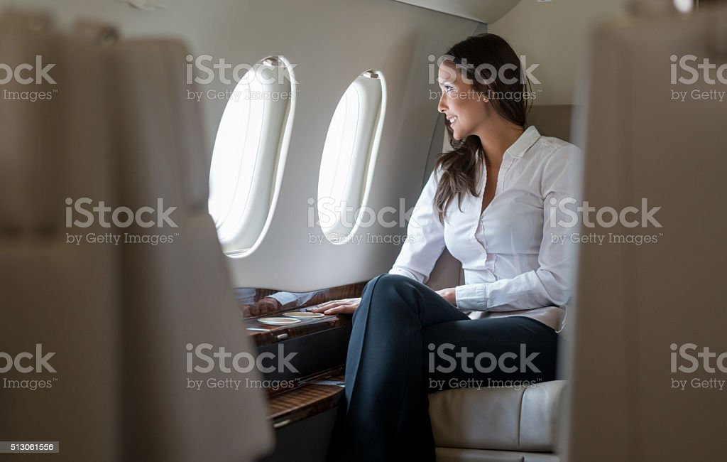 Successful woman in a business trip stock photo