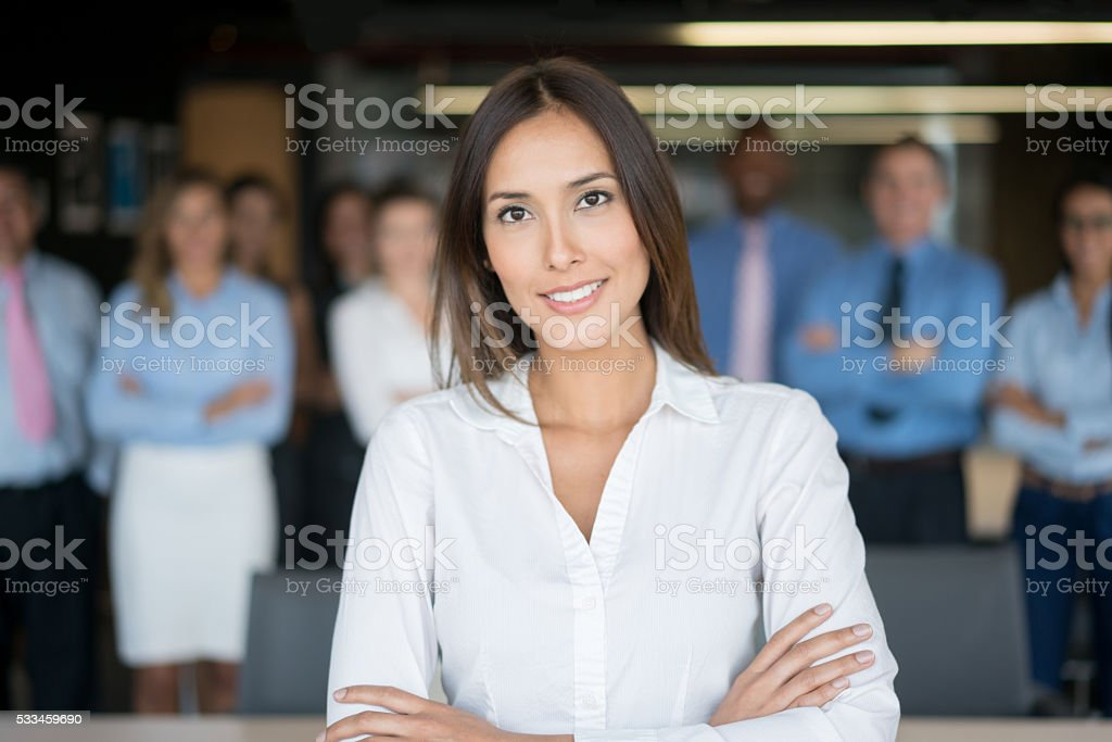 Successful woman leading a business group stock photo