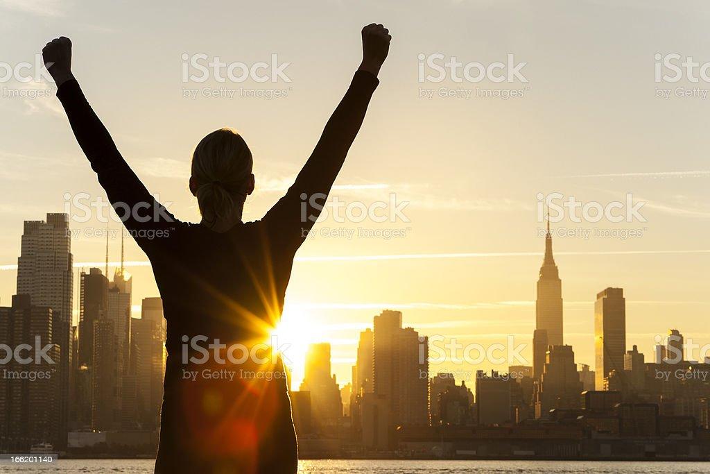 Successful Woman Sunrise New York City Skyline stock photo