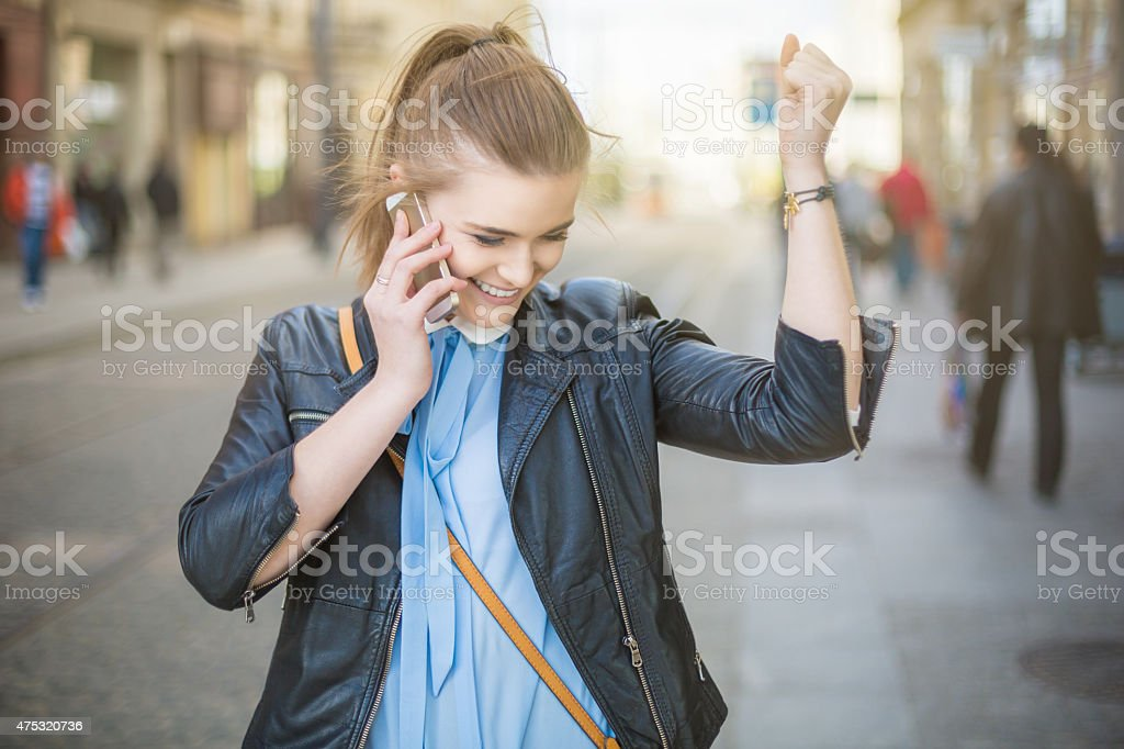 Successful woman talking on the phone on the street stock photo