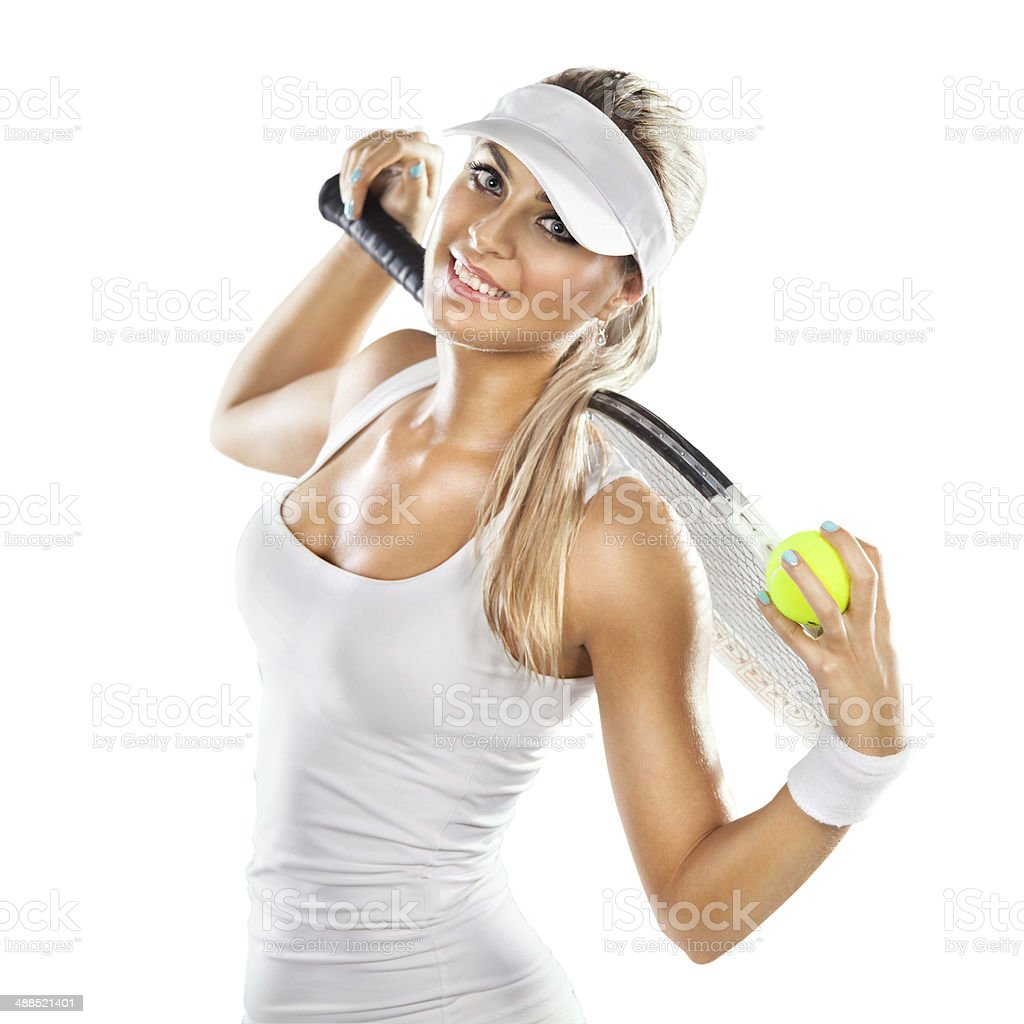 Successful woman with racket at the tennis court stock photo