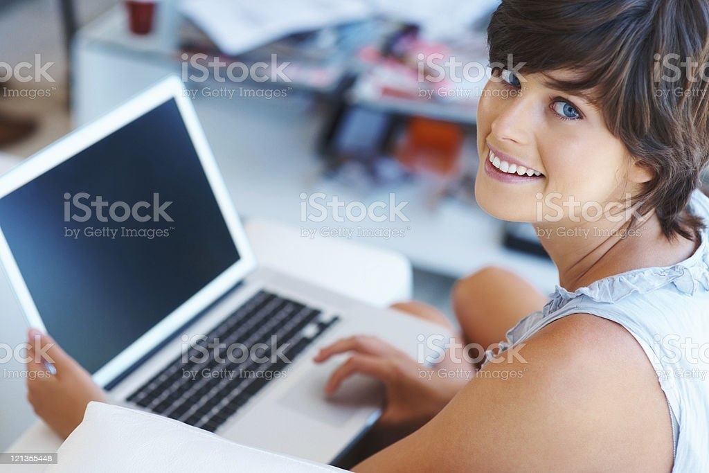 Successful woman working on a laptop royalty-free stock photo