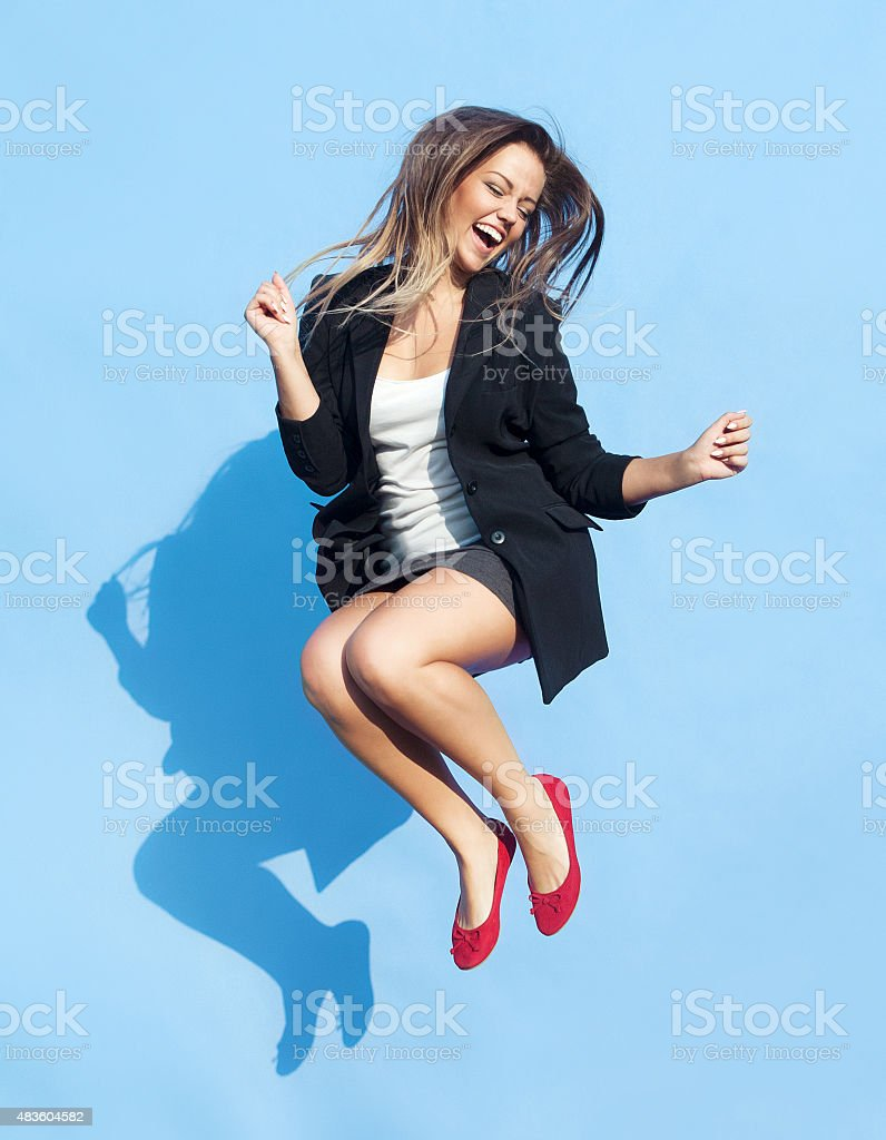 Successful young attractive laughing woman stock photo
