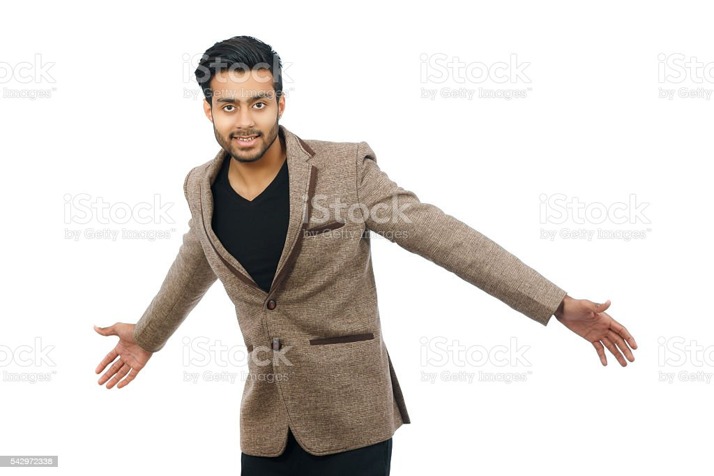 Successful young business man smiling with arms outstretched stock photo