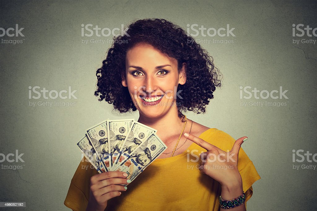successful young business woman holding money dollar bills stock photo
