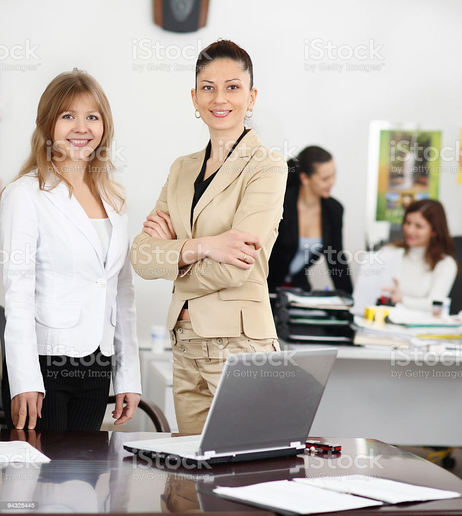 Successful young business women in office. stock photo
