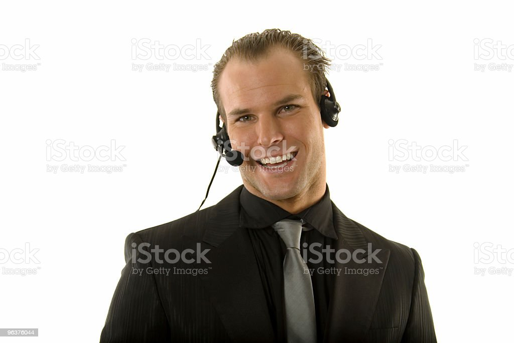 Successful young businessman wearing headphones royalty-free stock photo