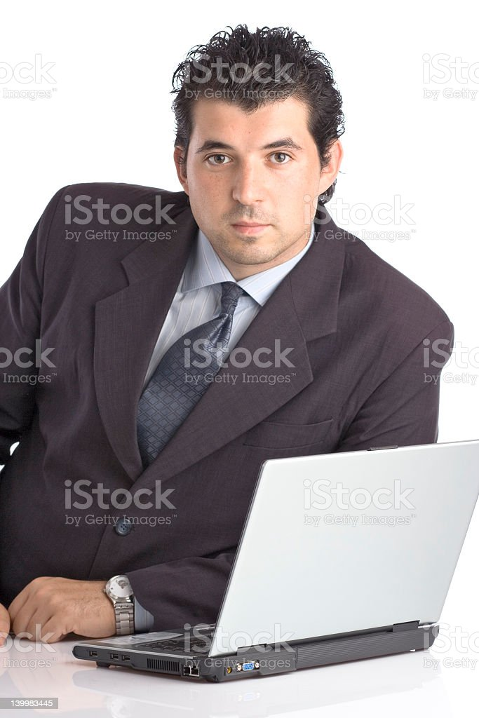 Successful young businessman with a lap top computer royalty-free stock photo