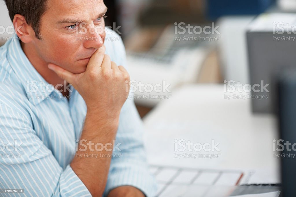 Successful young businessman working on computer stock photo