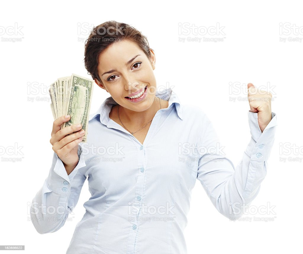 Successful young businesswoman holding currency against white royalty-free stock photo