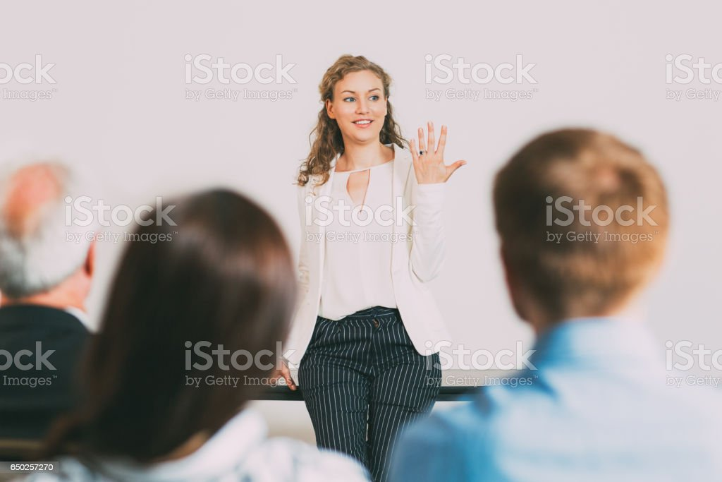 Successful Young Businesswoman Holding Report stock photo