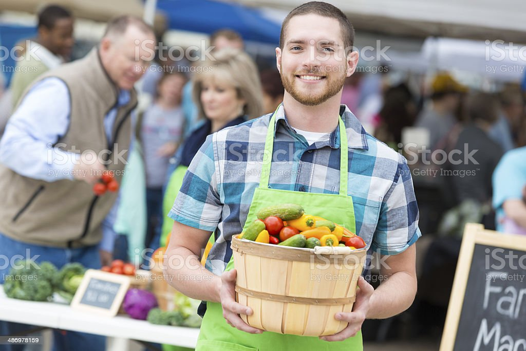 Successful young entrepreneur at the farmers market stock photo
