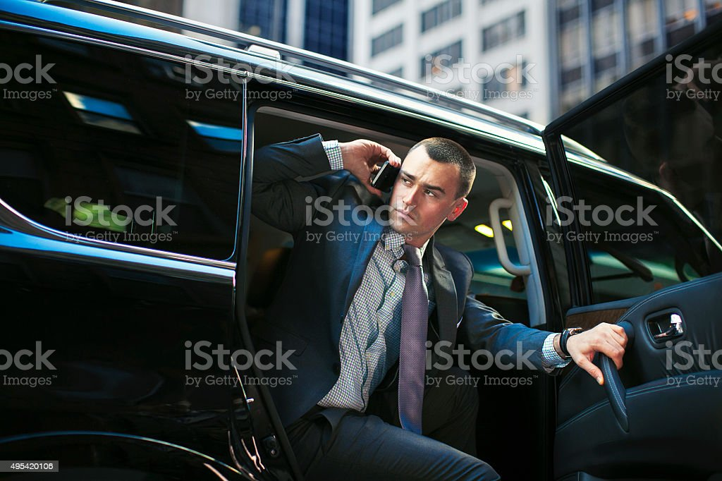 Successful young executive in luxury car stock photo