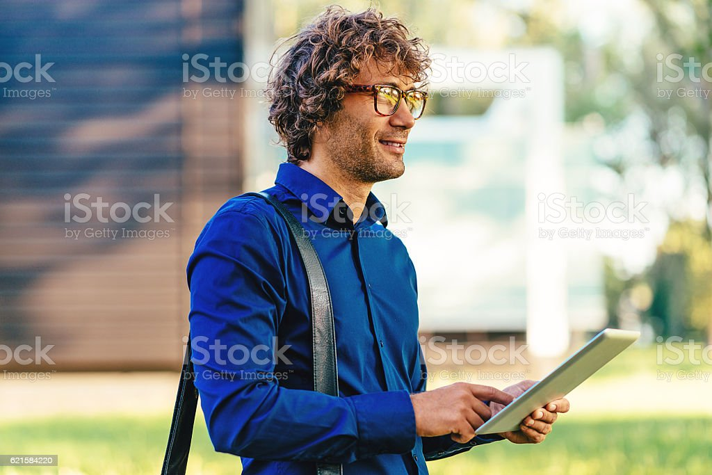Successful young man using internet stock photo