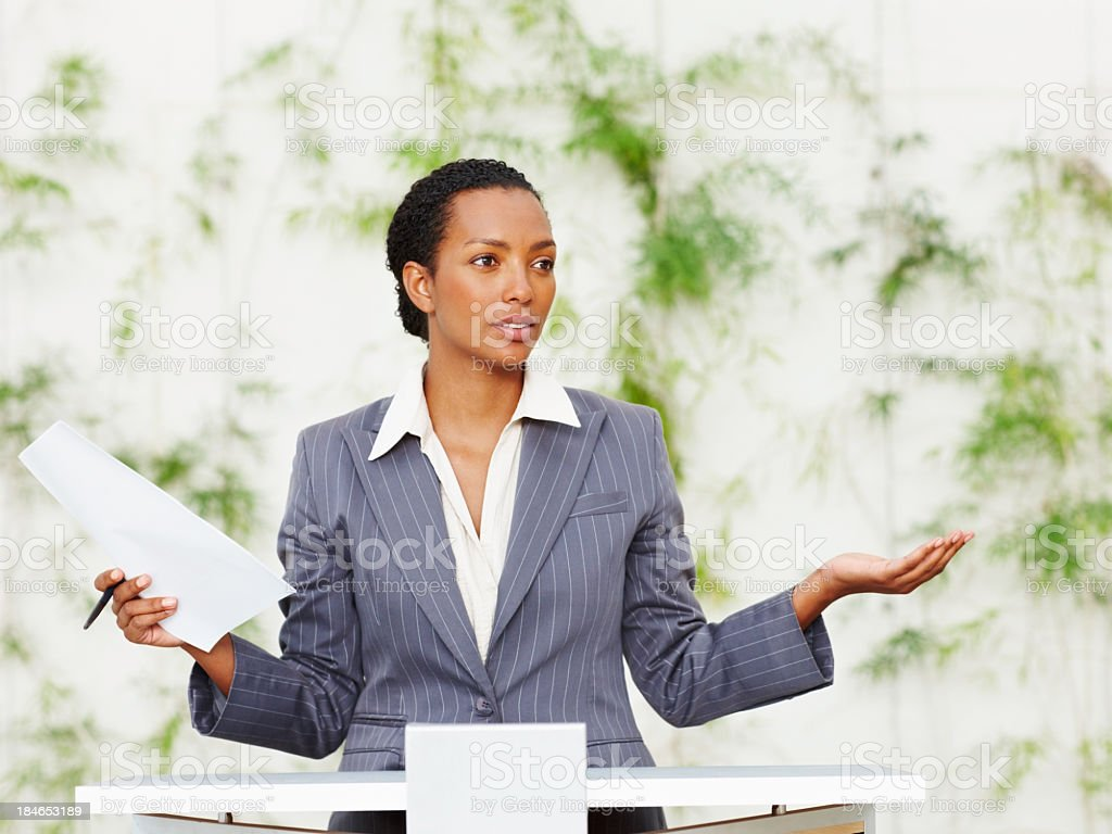 Successful young woman doing presentation with sketch royalty-free stock photo