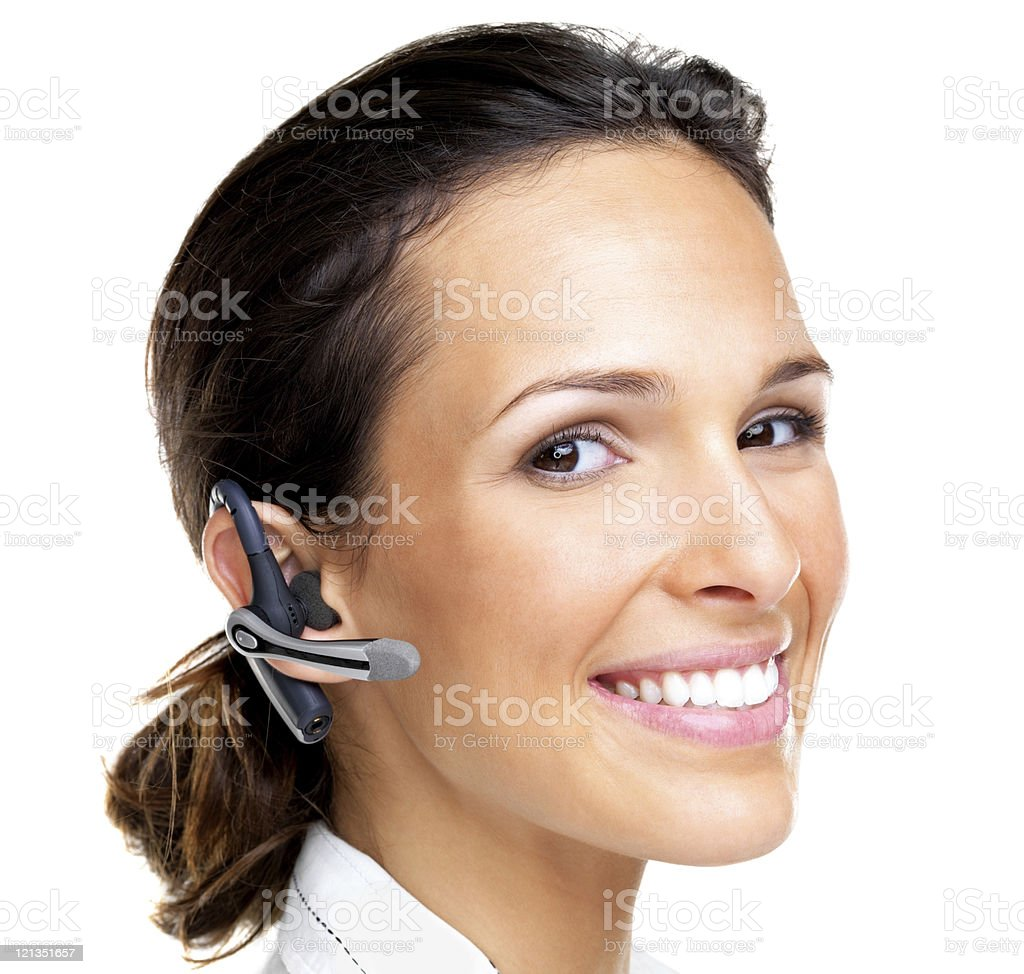 Successful young woman wearing a bluetooth handsfree royalty-free stock photo