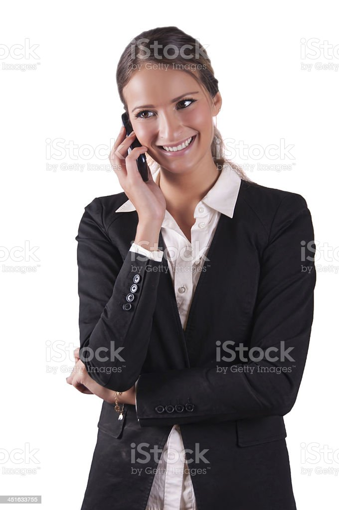 Successfull corporate woman in black jacket holding cell phone smiling stock photo