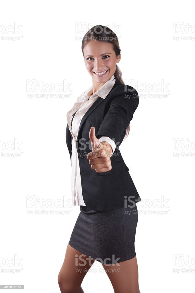 Successfull sexy corporate woman smiling giving thumbs up stock photo