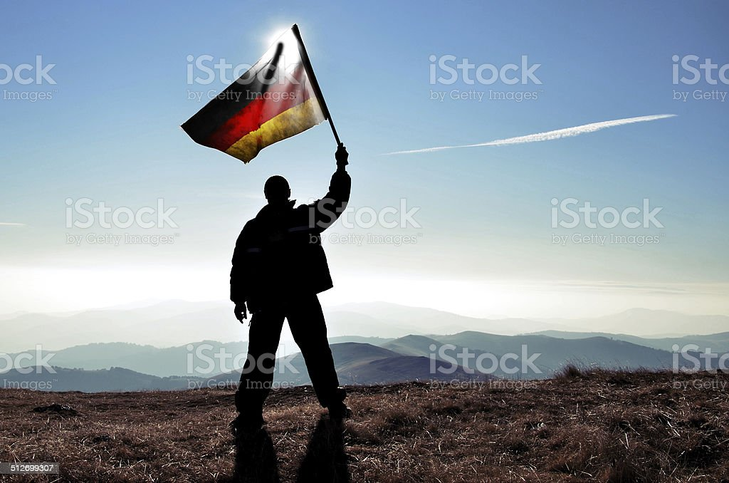successfull silhouette businessman winner waving German flag, vintage stock photo