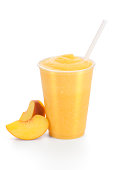 Succulent peach smoothie with peaches on the side