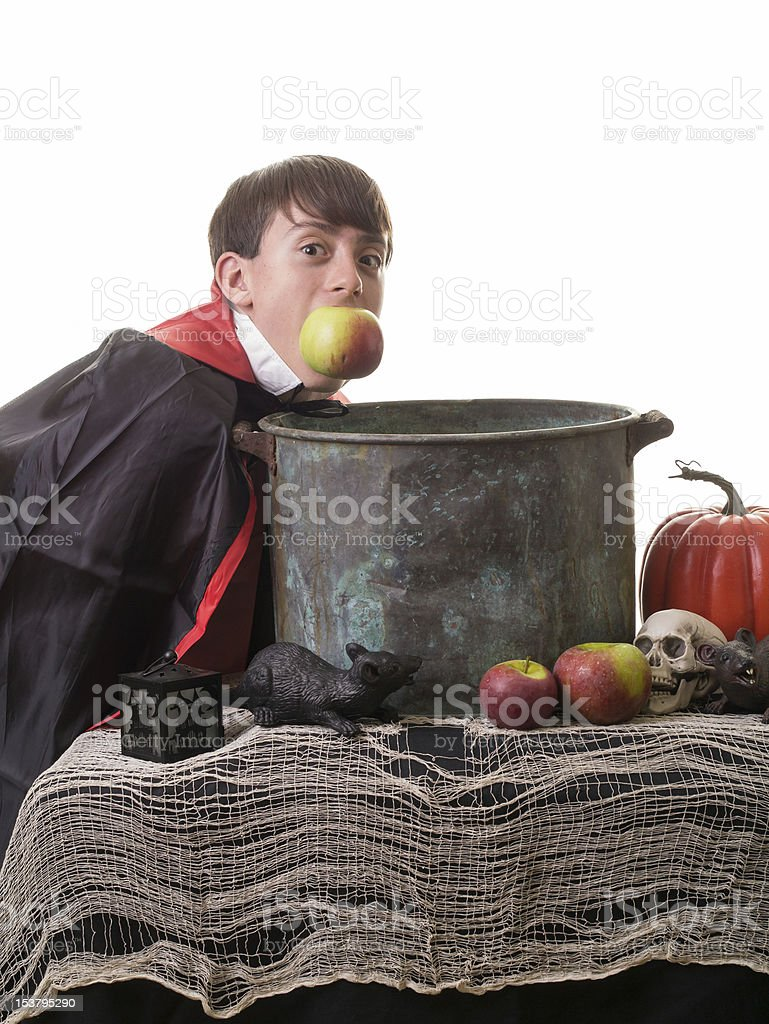 Sucessful kid in vampire costume at a Halloween party stock photo
