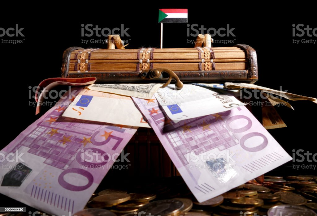 Sudanese flag on top of crate full of money stock photo