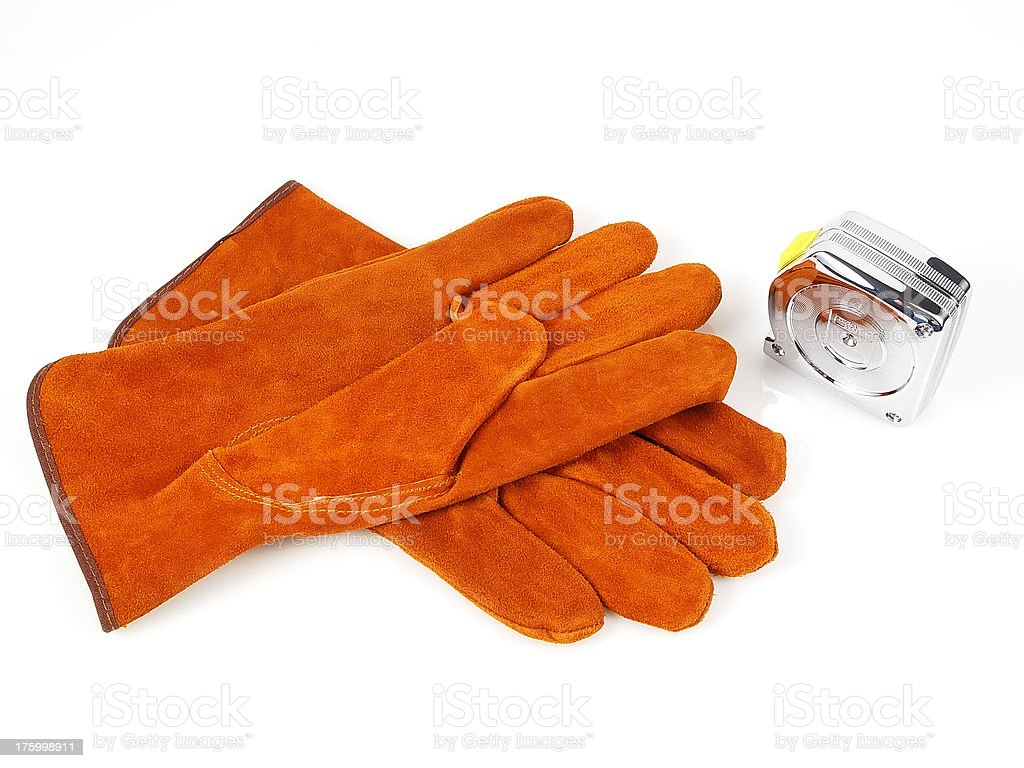 Suede gloves and measuring tape royalty-free stock photo