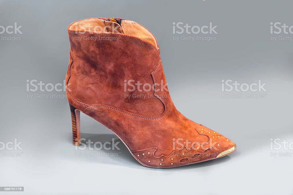Suede high heel bootie with gold nose stock photo