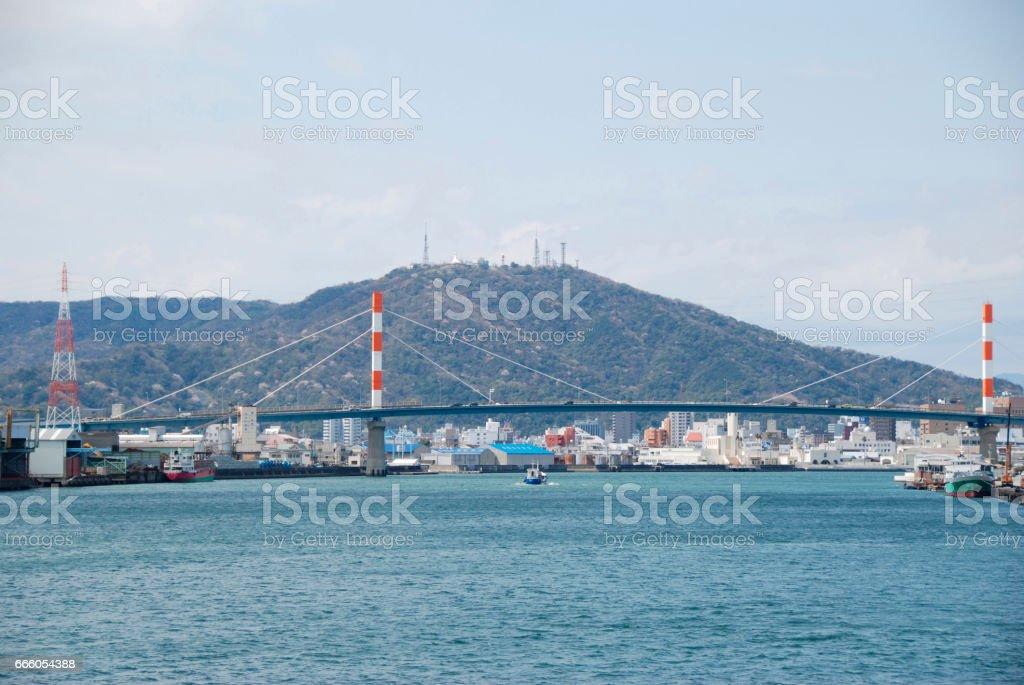 Suehiro bridge seen from the port of Tokushima and mayu-Yama stock photo