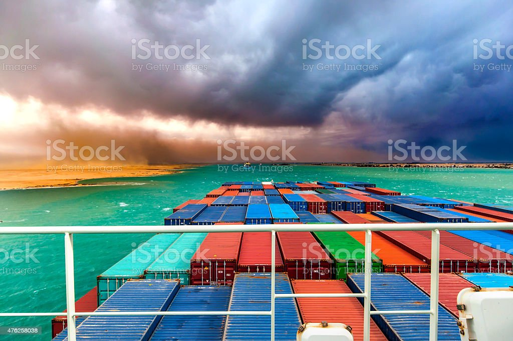 Suez Canal - Ships passing and desert storm approaching stock photo