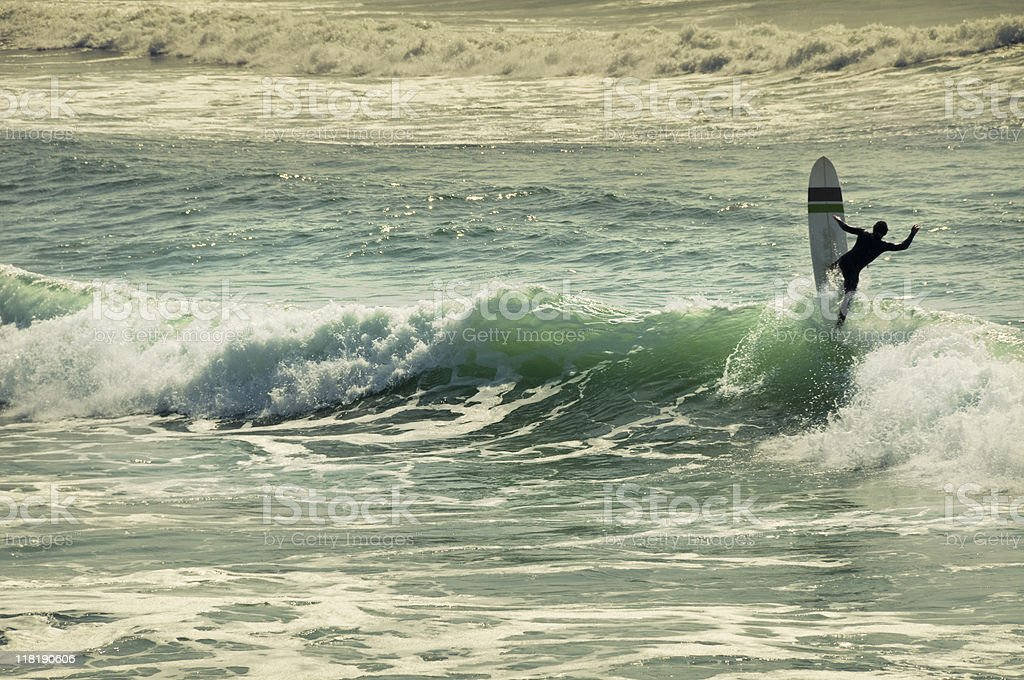 Sufer on a wave stock photo