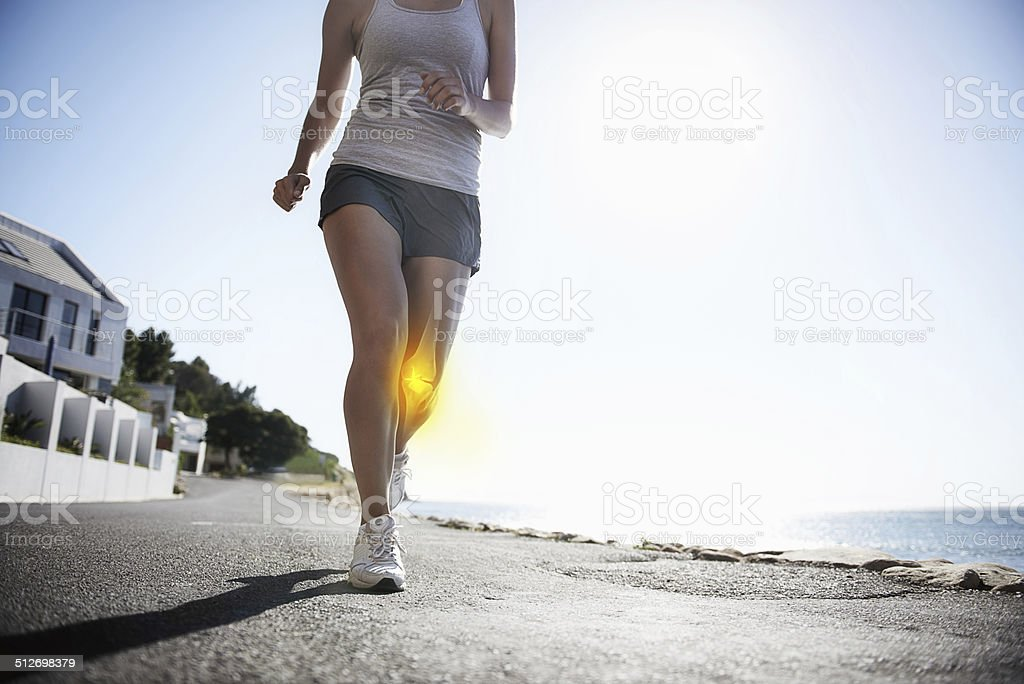 Suffering from knee pain stock photo
