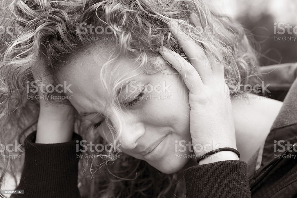 Suffering from tinnitus royalty-free stock photo