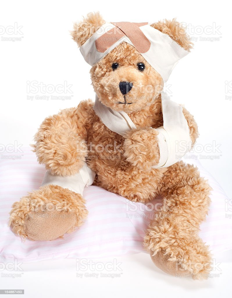 Suffering Sick and Injured Sweet Teddy Bear in Hospital royalty-free stock photo