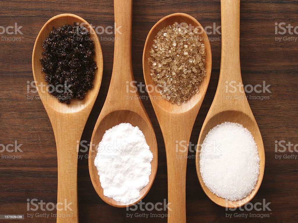 Sugar and spoons stock photo