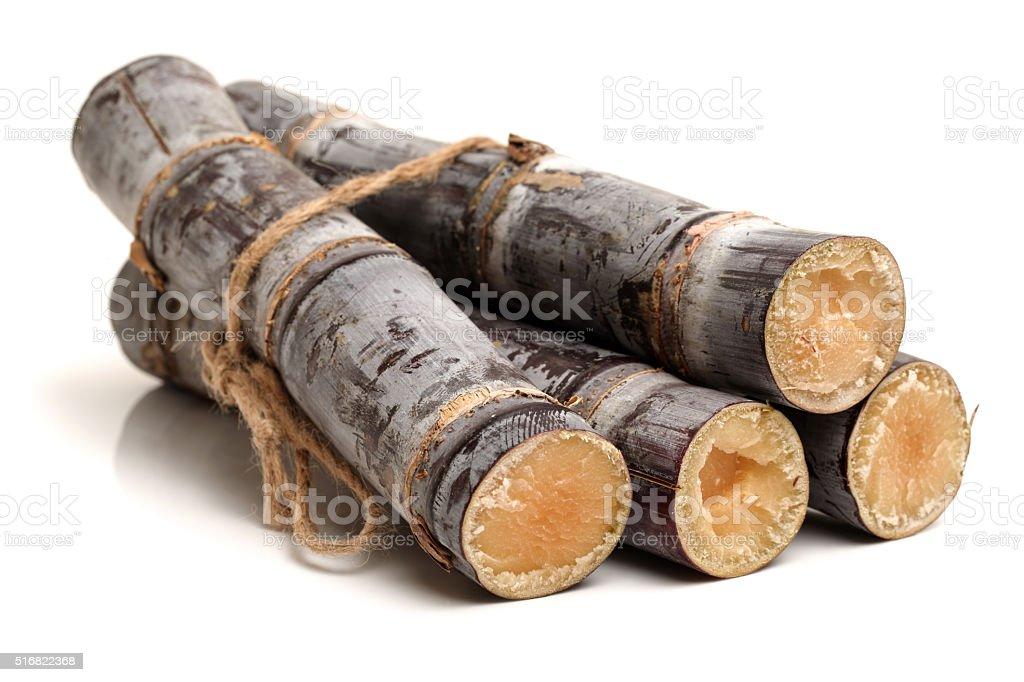 Sugar cane sticks arranged stock photo